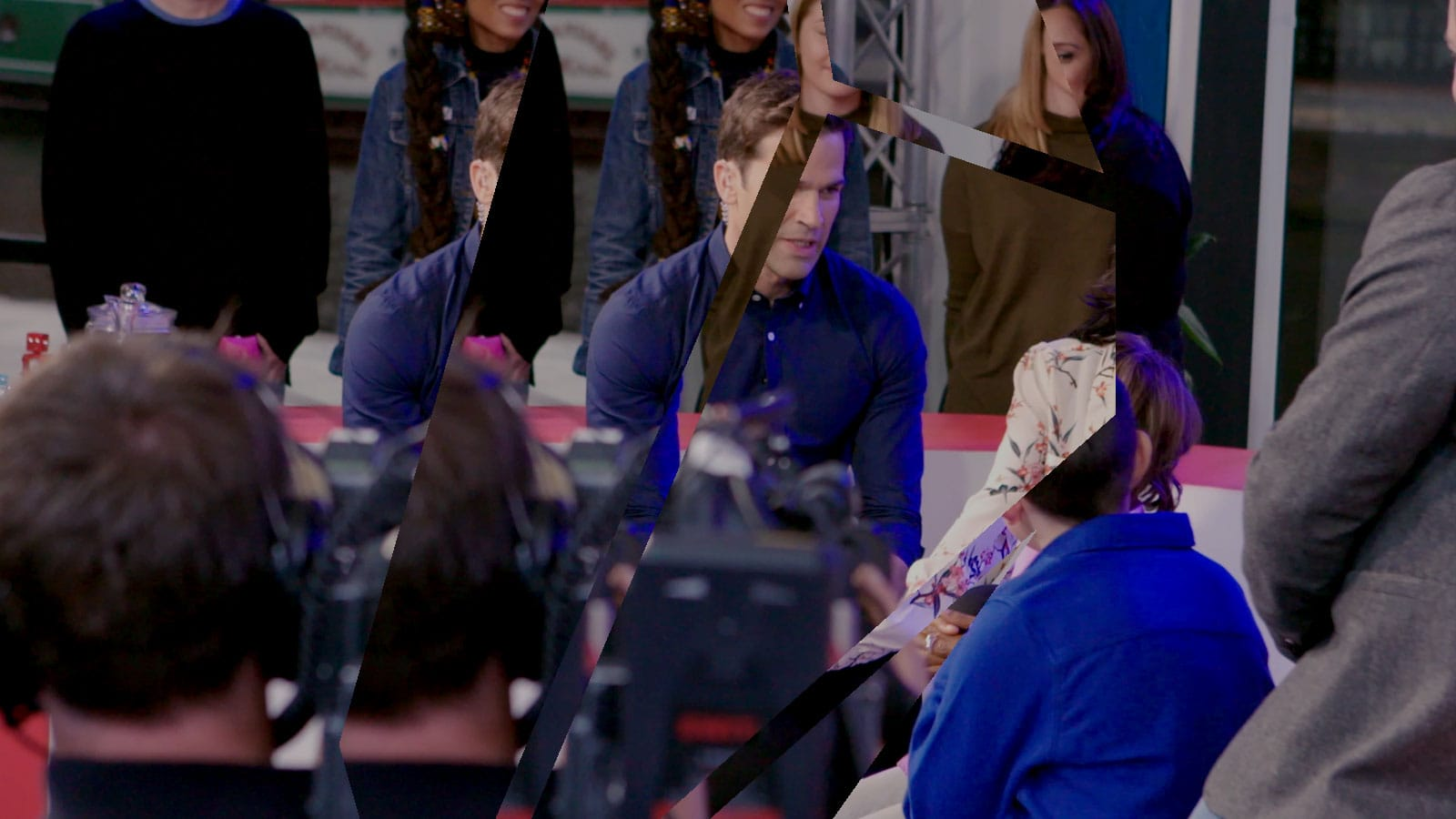 Image of live recording for natwest, we see the presenter talking to some women.
