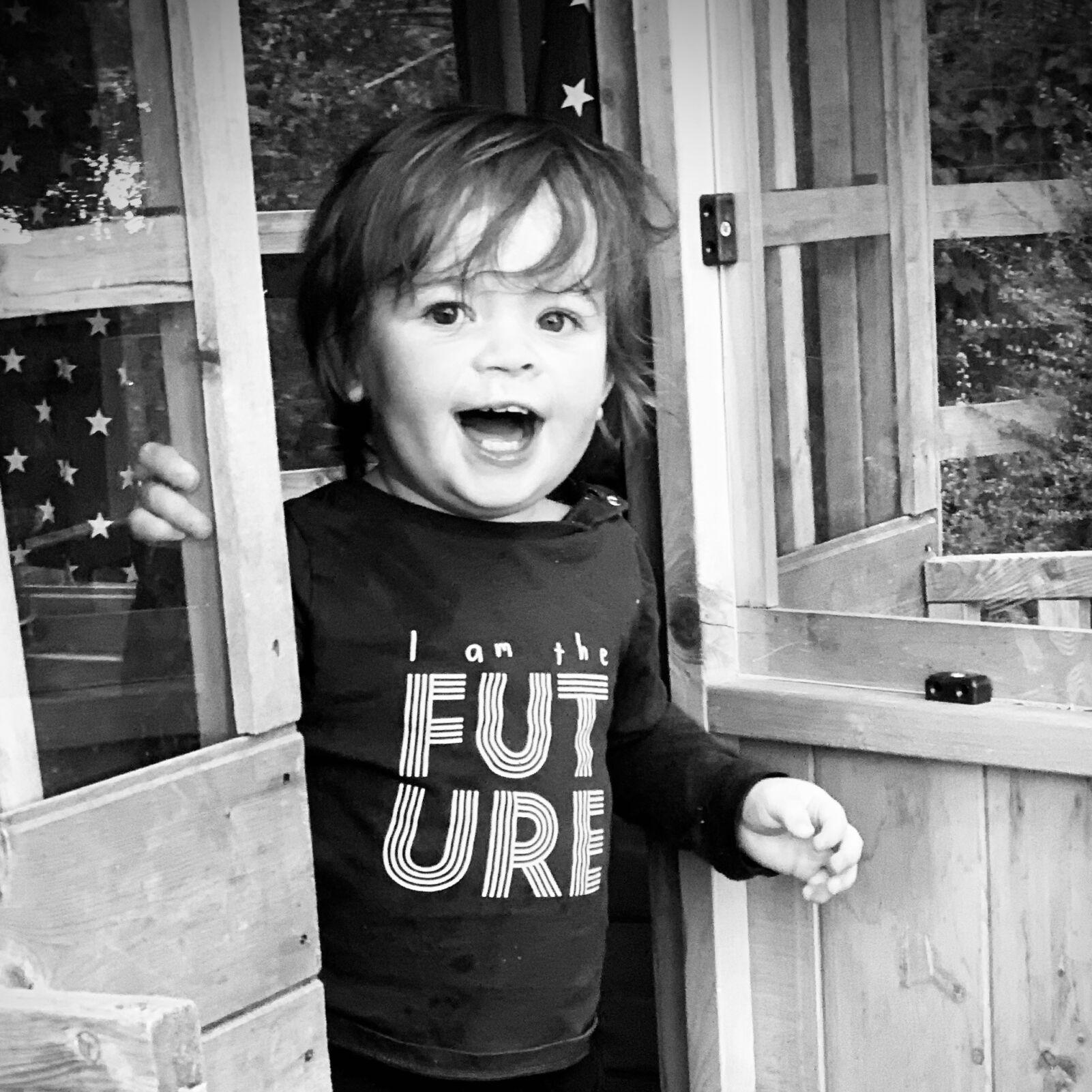 child wearing I am the future tshirt